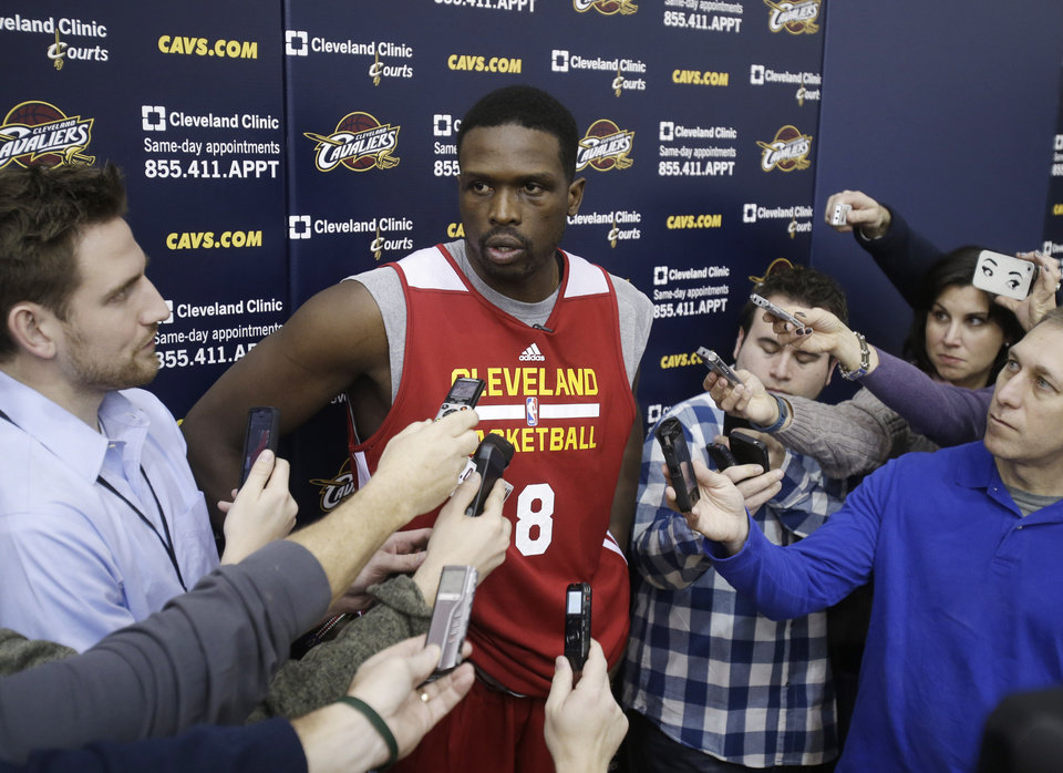 Photo - New Cleveland Cavaliers forward Luol Deng talks with reporters after his first practice with the NBA team at their practice facility in Independence, Ohio Wednesday, Jan. 8, 2014. The Cavaliers traded Andrew Bynum and future draft choices for the two-time All-Star Tuesday. (AP Photo/Mark Duncan)