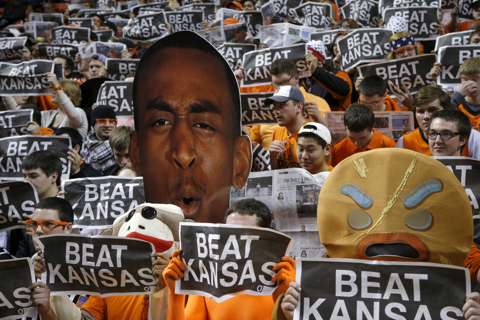 Photo - Oklahoma State fans hold up signs as the Kansas team is introduced before an NCAA college basketball game between Oklahoma State University (OSU) and the University of Kansas at Gallagher-Iba Arena in Stillwater, Okla., Saturday, March 1, 2014. Photo by Bryan Terry, The Oklahoman