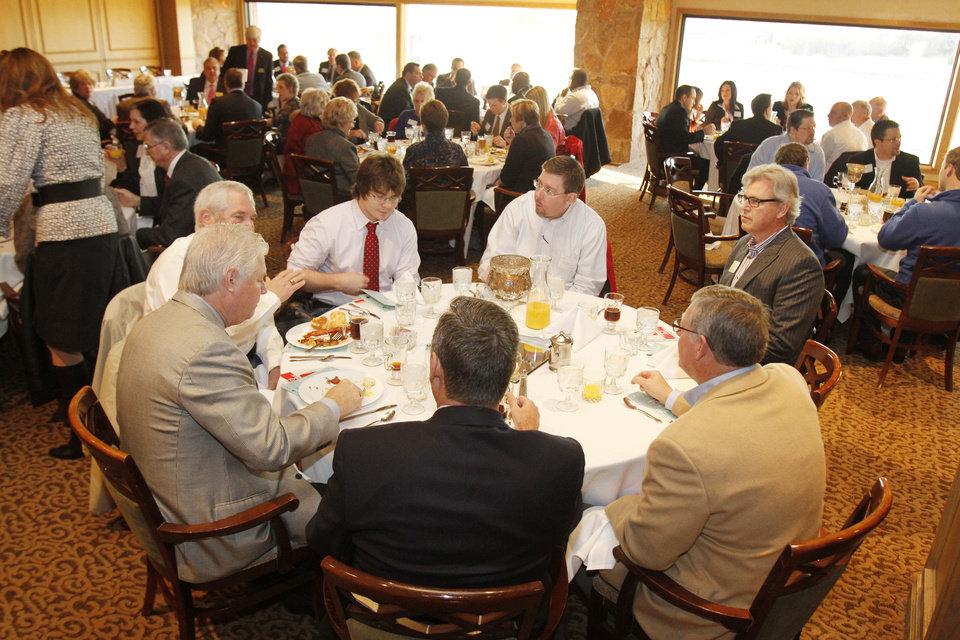 The newest Edmond-area Legislator, Mike Turner, center, sits with Edmond city and University of Central Oklahoma officials and others during the pre-session Legislative breakfast sponsored by Edmond Area Chamber of Commerce. PHOTO BY PAUL HELLSTERN, THE OKLAHOMAN. <strong>PAUL HELLSTERN - THE OKLAHOMAN</strong>