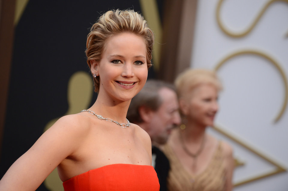 Photo - Jennifer Lawrence arrives at the Oscars on Sunday, March 2, 2014, at the Dolby Theatre in Los Angeles.  (Photo by Jordan Strauss/Invision/AP)