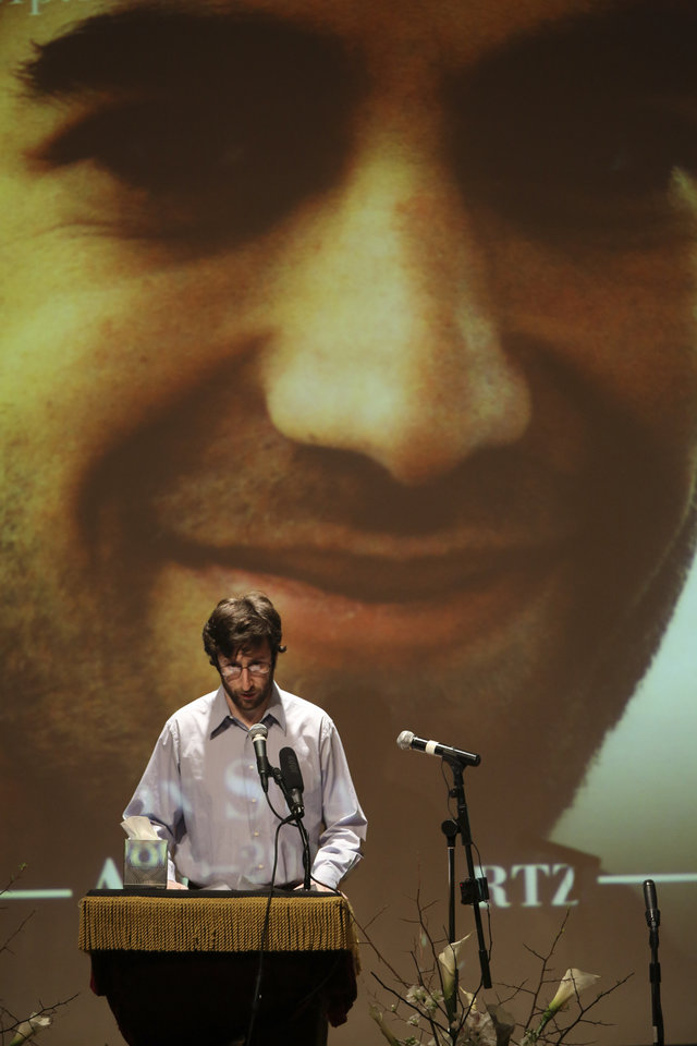 Photo - Holden Karnosfsky, Co-Founder and Co-Executive Director of GiveWell speaks during the memorial service for Aaron Swartz, Saturday, Jan. 19, 2013 in New York. Friends and supporters of Swartz paid tribute Saturday to the free-information activist and online prodigy, who killed himself last week as he faced trial on hacking charges. (AP Photo/Mary Altaffer)