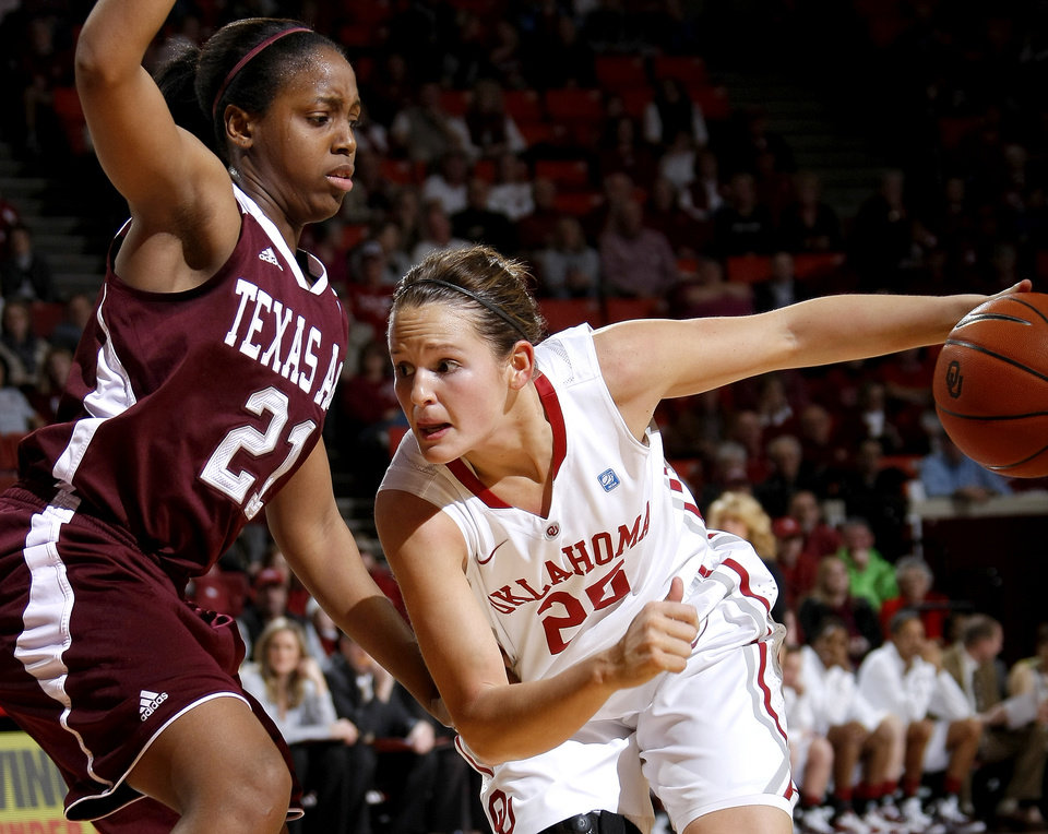 Photo - OU's Whitney Hand (25) drives past Texas A&M's Adaora Elonu (21) during the Big 12 women's basketball game between the University of Oklahoma and Texas A&M at Lloyd Noble Center in Norman, Okla., Wednesday January 26, 2011.  Photo by Bryan Terry, The Oklahoman