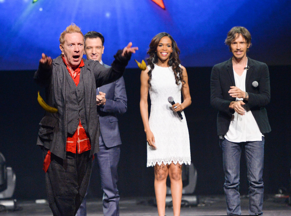 Photo - From left, singer John Rotten Lydon throws bananas at the media, JC Chasez, Michelle Williams and Brandon Boyd look on, at the