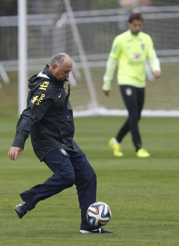 Photo - Brazil coach Luiz Felipe Scolari kicks the ball during a practice session at the Granja Comary training center in Teresopolis, Brazil, Friday, July 11, 2014. Brazil will face the Netherlands in the World Cup third-place match Saturday. (AP Photo/Leo Correa)