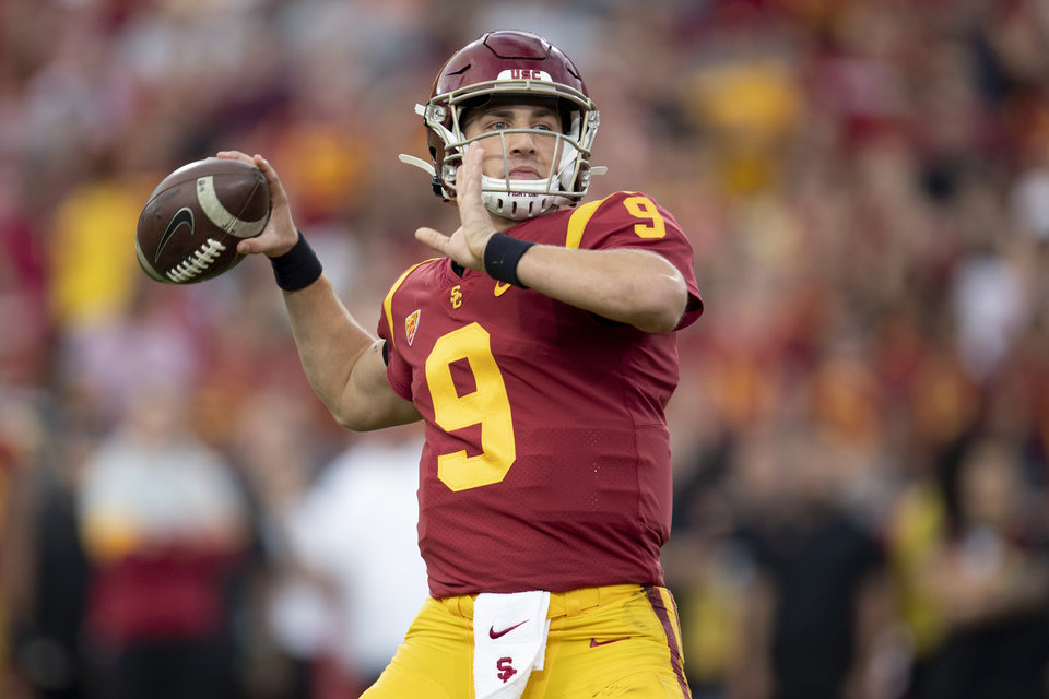 Photo - FILE - In this Nov. 2, 2019 file photo, Southern California quarterback Kedon Slovis throws a pass during the first half of an NCAA college football game against Oregon in Los Angeles. Slovis returns s quarterback for his sophomore season in November.  (AP Photo/Kyusung Gong, File)