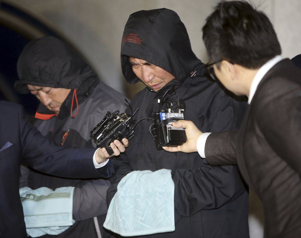 Photo - FILE - In this April 19, 2014 file photo, Lee Joon-seok, center, the captain of the sunken South Korean ferry Sewol, talks to the media before leaving a court which issued his arrest warrant in Mokpo, south of Seoul, South Korea. Prosecutors indicted the captain and three crew members on homicide charges Thursday, May 15, alleging they were negligent and failed to protect more than 300 people missing or dead in the disaster. Less serious indictments were issued against the 11 other crew members responsible for navigating the vessel. (AP Photo/Yonhap, File) KOREA OUT