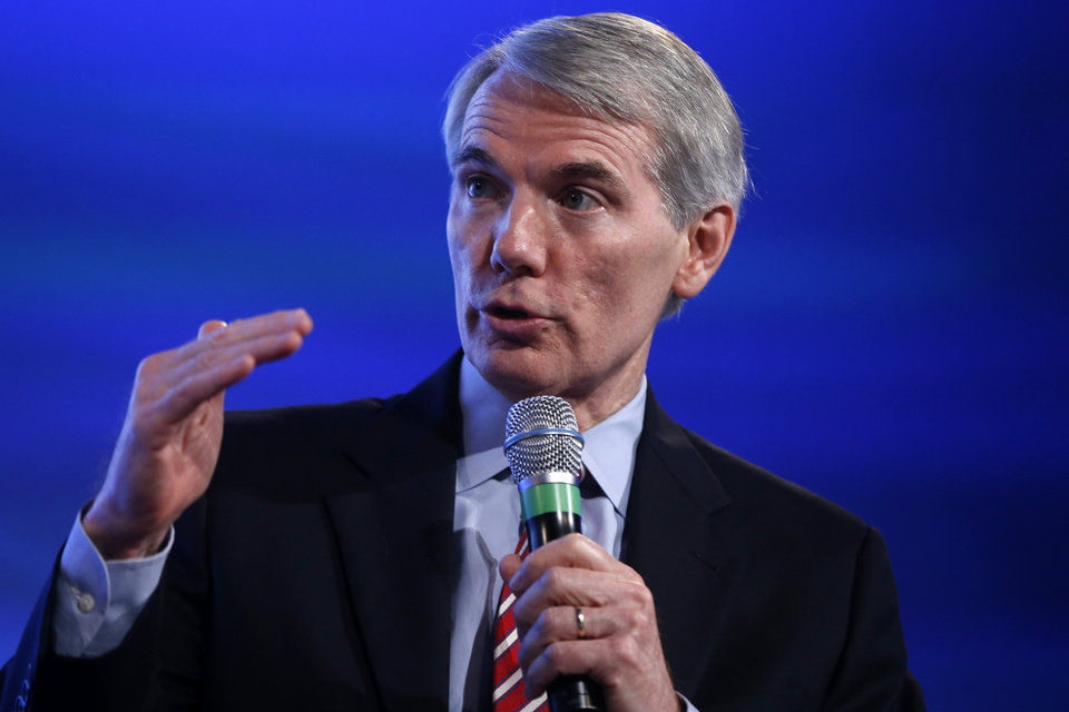 Photo - Senate Budget Committee member Sen. Rob Portman, R-Ohio, speaks at the 2014 Fiscal Summit organized by the Peter G. Peterson Foundation in Washington, Wednesday, May 14, 2014. Lawmakers and policy experts discussed America's long term debt and economic future. (AP Photo)