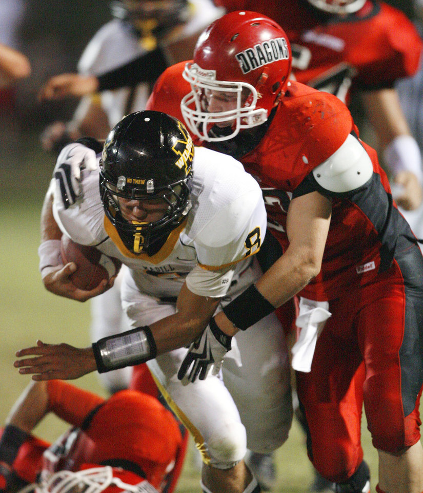 Photo - Madill's Spencer Bond (8) carries and Purcell's Andrew Gray (17) makes the tackle in high school football as Madill plays at Purcell on Thursday, Oct. 1, 2010, in Purcell, Okla.  Photo by Steve Sisney, The Oklahoman