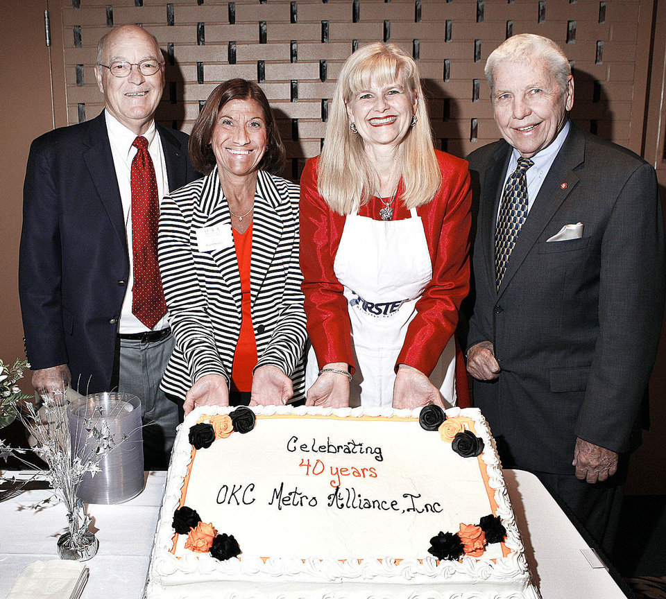 Photo - Hank Bradley, Barbara Young, Cheryl Borelli and Gib Gibson with the 40th celebration cake while attending the OKC Metro Alliance fundraising luncheon at St. Luke's United Methodist Church in Oklahoma City Thursday, April 25, 2013.  Photo by Paul B. Southerland, The Oklahoman