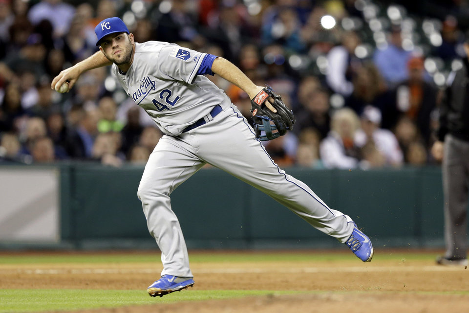 Photo - Kansas City Royals third baseman Mike Moustakas throws to first base for the out on Houston Astros' Matt Dominguez in the fourth inning of a baseball game Tuesday, April 15, 2014, in Houston. (AP Photo/Pat Sullivan)