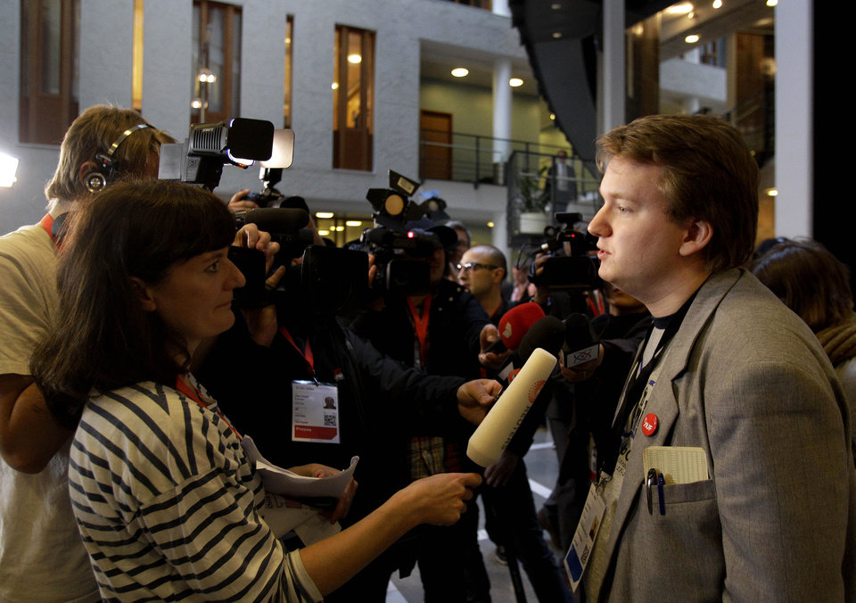 Photo -   Utoya shooting survivor Tore Sinding Bekkedal, right, speaks to the media in front of the courtroom where Anders Behring Breivik is appearing on terror and murder charges, Oslo, Norway, Monday, April 16, 2012. Breivik, who admitted to killing 77 people in Norway, has pleaded not guilty in court to terror and murder charges saying he was acting in self-defense. (AP Photo/Frank Augstein)