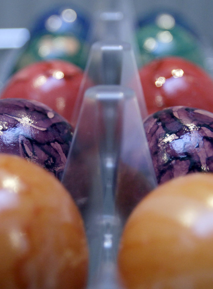 Painted Easter eggs are seen in a supermarket in Antwerp, Belgium on Tuesday, March 27, 2012. Demand for eggs is traditionally reaching its peak around this festive Easter season and the industry has been hit hard by the European Union's mandatory use of more animal friendly battery cages for hens since the beginning of the year. Because of the legislation, some farmers have closed up rather than face the cost of transformation. Others are busy renovating their installations and others can continue using their old systems until August but can only sell eggs in liquid form. (AP Photo/Virginia Mayo)
