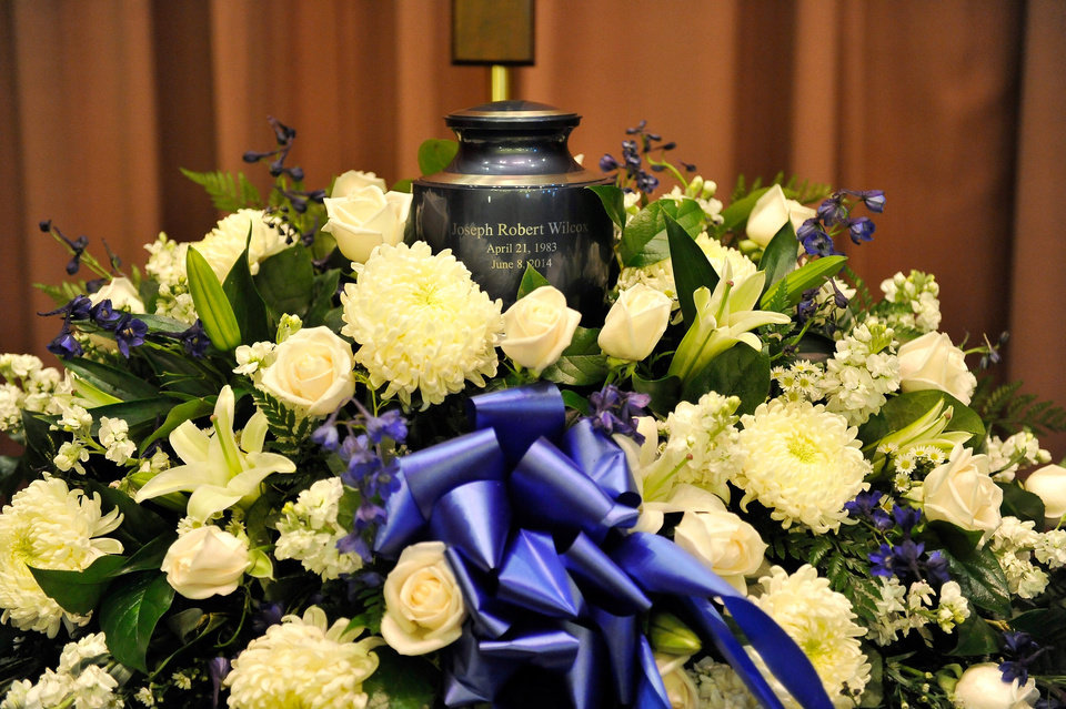 Photo - An urn containing the remains of Joseph Wilcox is displayed during a memorial service for him at Palm Downtown Mortuary on Sunday, June 22, 2014, in Las Vegas. Wilcox went for his own legal and concealed handgun after a couple killed Officers Igor Soldo and Alyn Beck at a nearby pizza shop and walked into a Wal-Mart, fired a shot in the air, and declared the start of a revolution two weeks ago. (AP Photo/Las Vegas Review-Journal, David Becker, Pool)