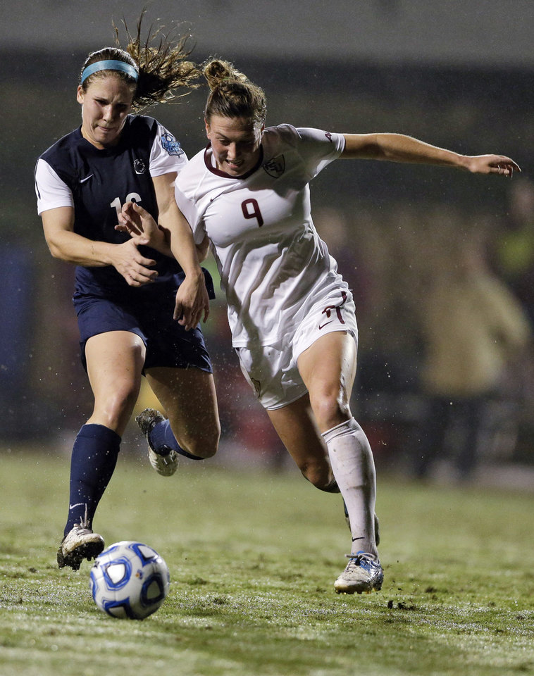 Photo - Penn State's Mallory Weber, left, and Florida State's Kassey Kallman race for the ball during the first half in an NCAA women's college soccer tournament semifinal, Friday, Nov. 30, 2012, in San Diego. (AP Photo/Gregory Bull)