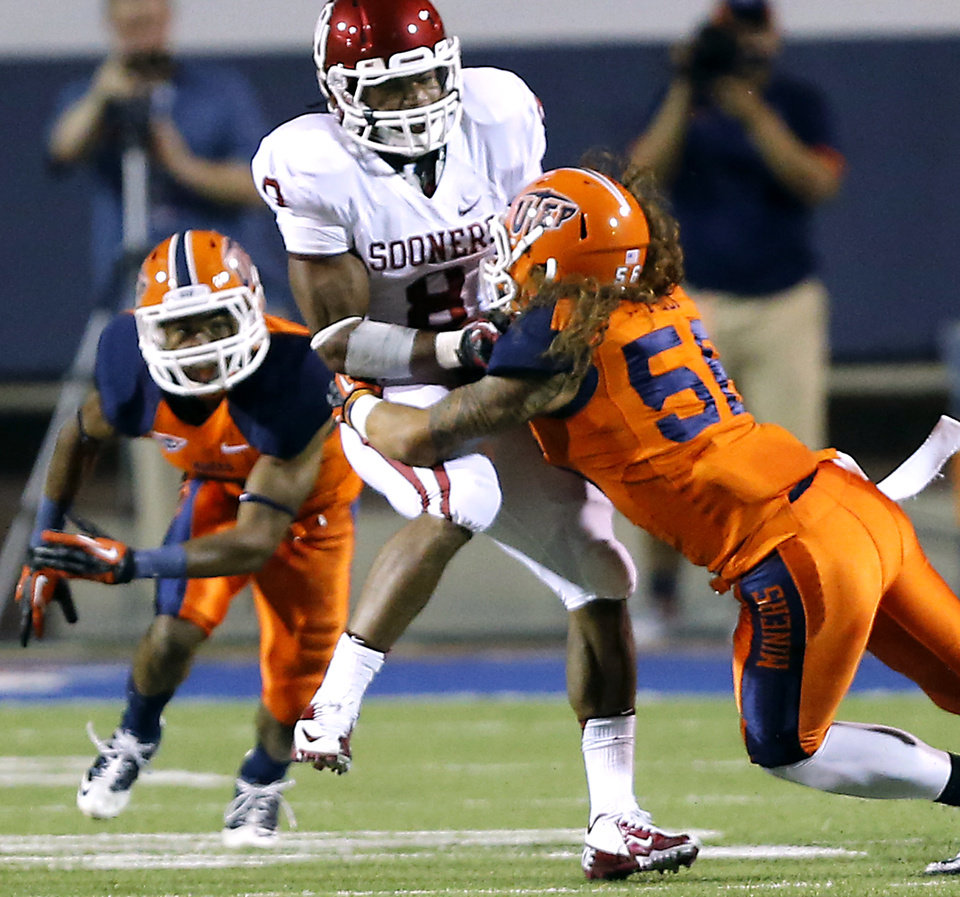 Photo - Oklahoma Sooners running back Dominique Whaley (8) is hit by UTEP's Josh Fely (56) during the college football game between the University of Oklahoma Sooners (OU) and the University of Texas El Paso Miners (UTEP) at Sun Bowl Stadium on Saturday, Sept. 1, 2012, in El Paso, Tex.  Photo by Chris Landsberger, The Oklahoman