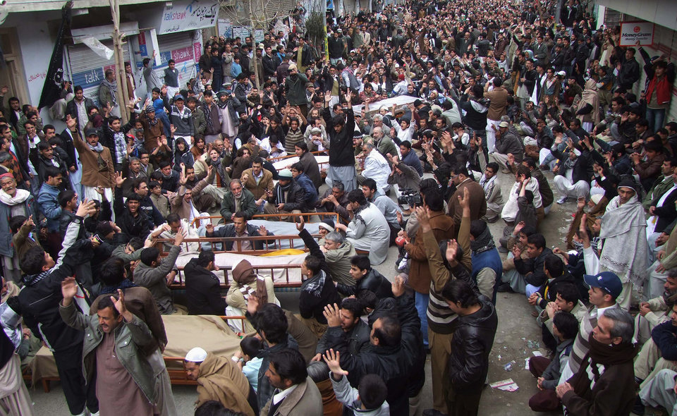 Pakistani Shiite Muslims chant slogans next to the bodies of their relatives awaiting burial, who were killed in Thursday\'s deadly bombings, at a protest rally, Friday, Jan. 11, 2013 in Quetta, Pakistan. Shiites in a southwestern Pakistani city hit by a brutal terror attack refused to bury their dead Friday in protest, demanding that the government do something to protect them from what has become a barrage of bombings and shootings against the minority Muslim sect. (AP Photo/Arshad Butt)