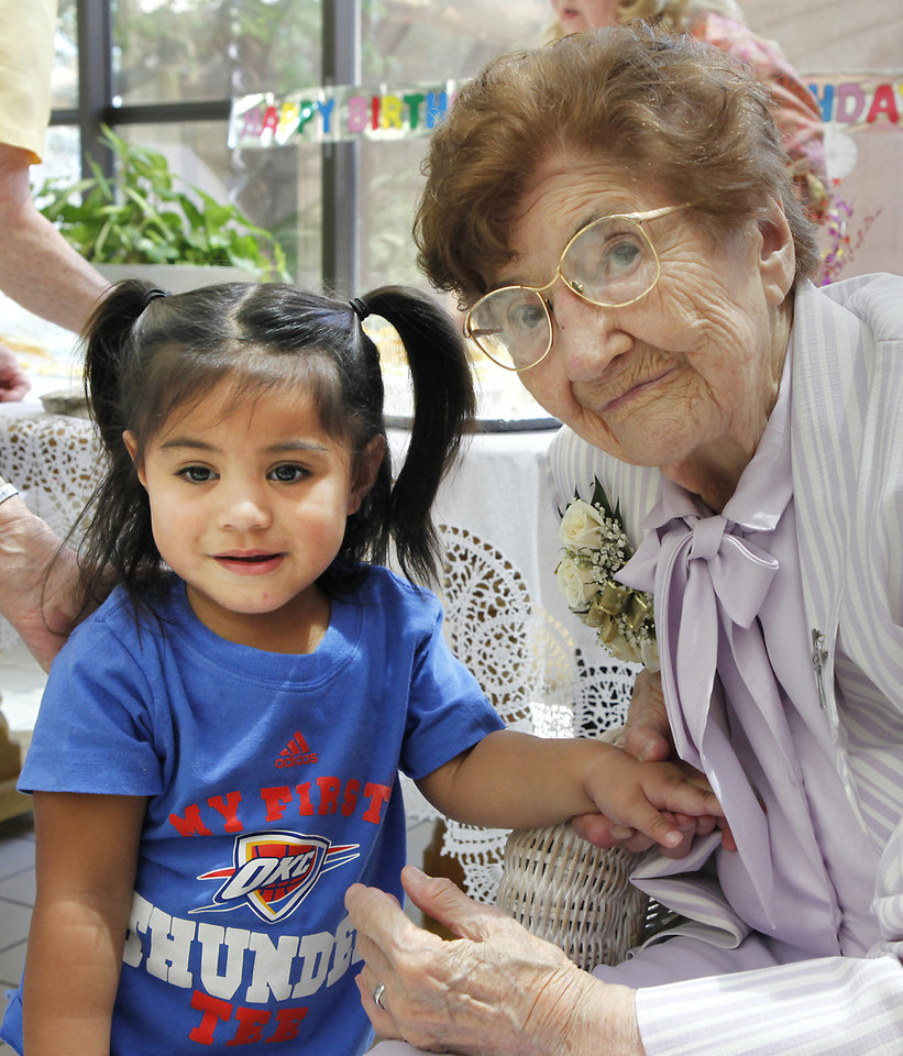 Mercy Tasi, 2, poses for a photo with Sister Mary Clotilda Toelle  who is celebrating her 100 birthday at The Mercy Convent next to Mercy Hospital, Wednesday, June 27, 2012. Mercy's mother worked at the hospital and she was named after it. Photo By David McDaniel/The Oklahoman