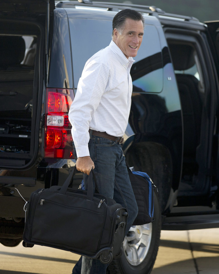 Photo -   Republican presidential candidate, former Massachusetts Gov. Mitt Romney boards his campaign plane for an event in Iowa on Friday, Sept. 7, 2012 in Portsmouth, N.H. (AP Photo/Evan Vucci)