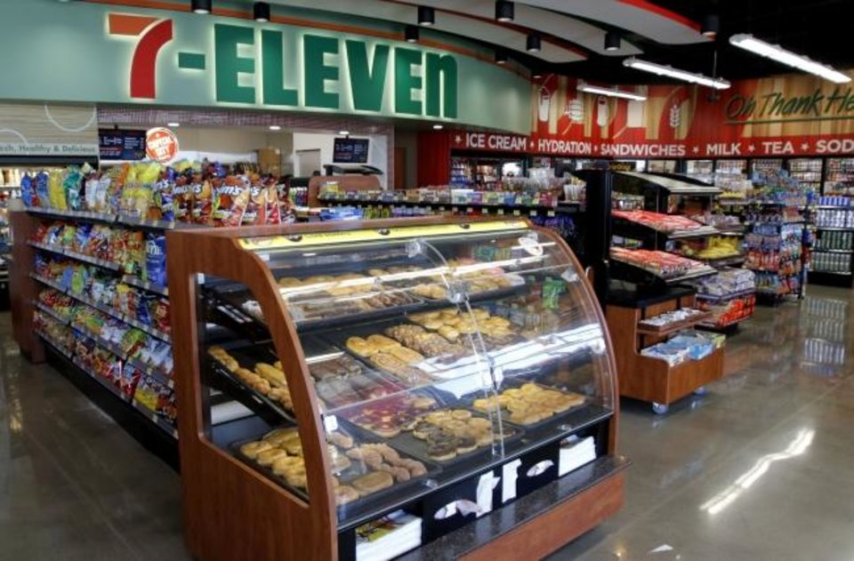 Photo -  7-Eleven Stores began changing its operation several years ago to compete with another quickly-growing chain of convenience stores that was moving into the Oklahoma City area. The retailer began replacing older stores with larger ones like this one pictured in northwest Oklahoma City in 2015. The newer stores offer customers improved selections of products inside and more fuel pumps outside. On Friday, 7-Eleven Inc. announced it is buying 7-Eleven Stores for an undisclosed amount. [OKLAHOMAN ARCHIVES]