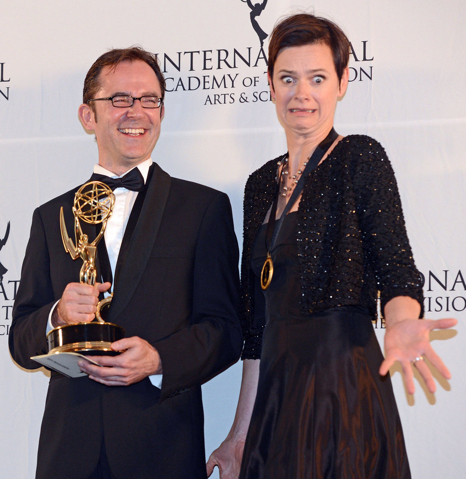 Photo -   Tristan Chytroschek, left, and Susanne Mertens of Germany pose with their statues after winning the Arts Programming award for