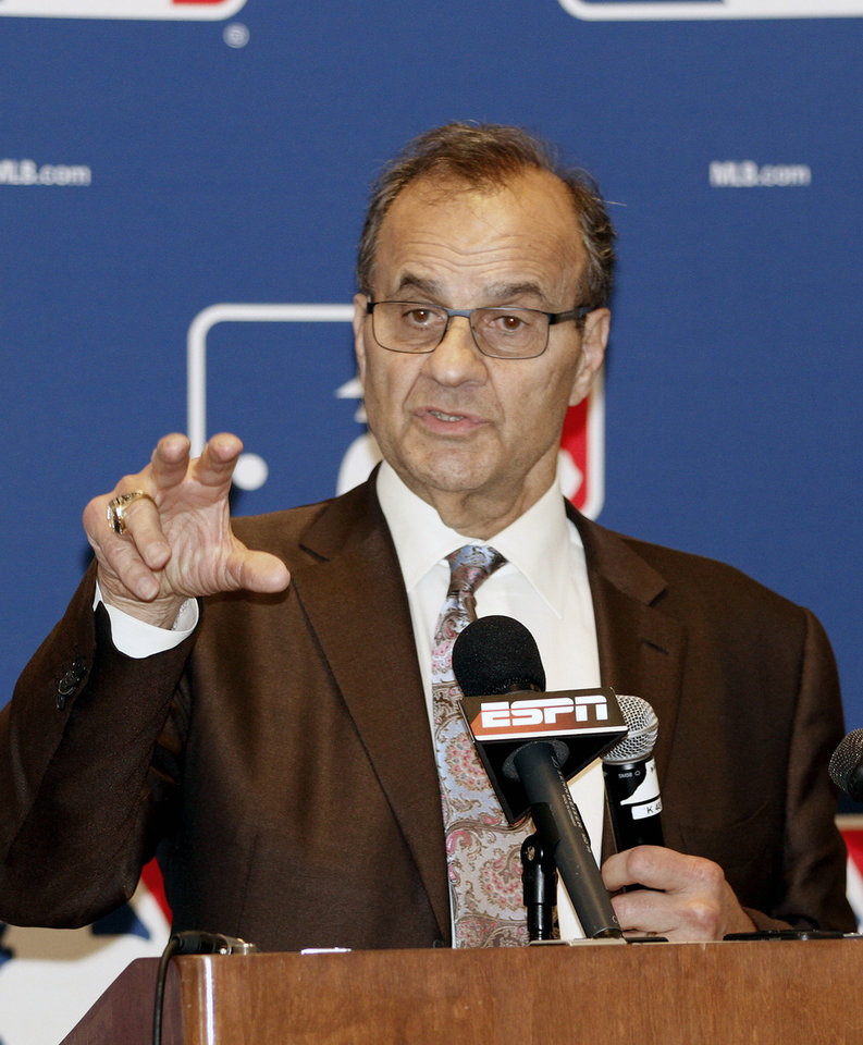 Photo - Major League Baseball executive Joe Torre talks with the media at the annual baseball general managers meeting, Tuesday, Nov. 12, 2013, in Orlando, Fla. (AP Photo/Reinhold Matay)