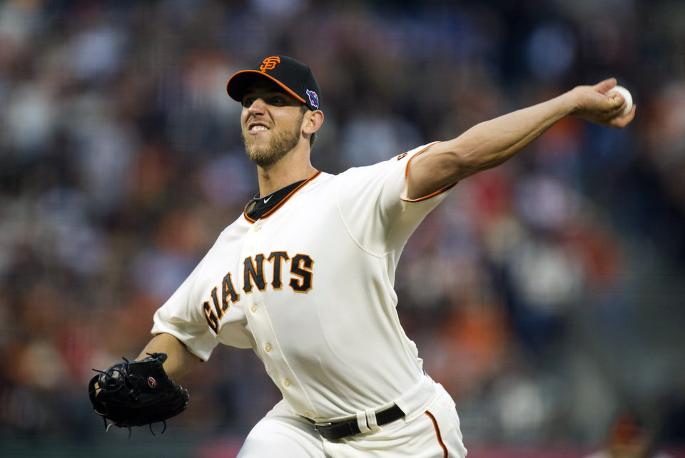 Photo -   San Francisco Giants starting pitcher Madison Bumgarner works in the first inning against the Cincinnati Reds in Game 2 of the National League division baseball series, Sunday, Oct. 7, 2012, in San Francisco. (AP Photo/The Sacrament Bee, Paul Kitagaki Jr.)