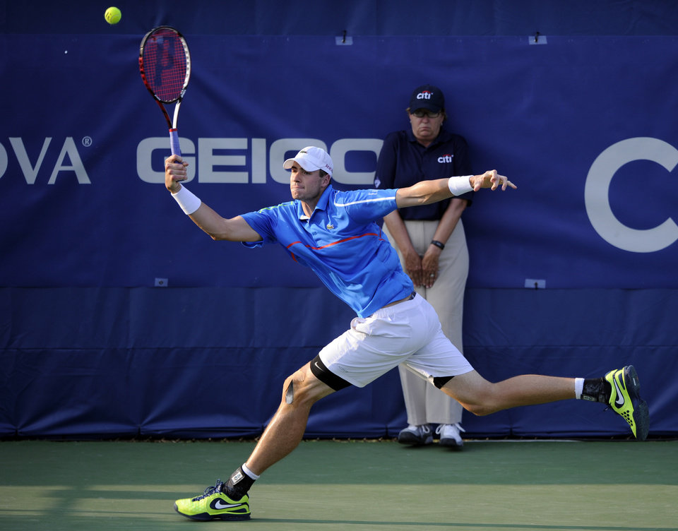 Photo - John Isner returns the ball against Steve Johnson during a match at the Citi Open tennis tournament, Wednesday, July 30, 2014, in Washington. (AP Photo/Nick Wass)