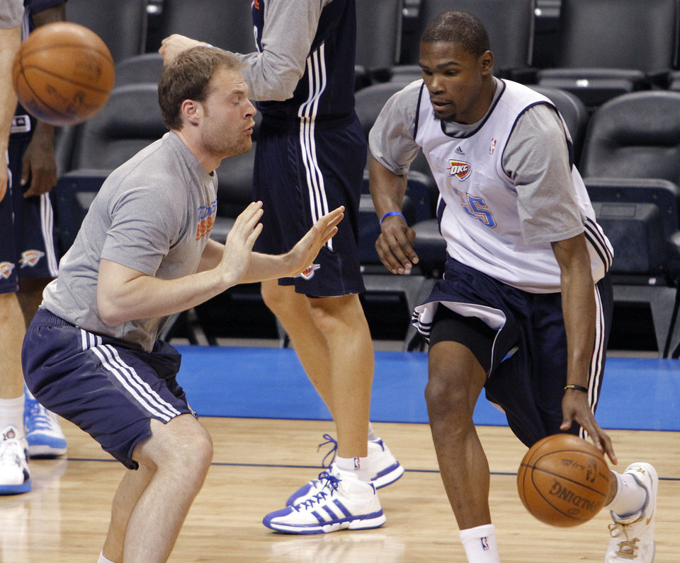 Photo - Dave Bliss goes through drills with Oklahoma City's Kevin Durant during the NBA Finals practice day at the Chesapeake Energy Arena on Monday, June 11, 2012, in Oklahoma City, Okla. Photo by Chris Landsberger, The Oklahoman