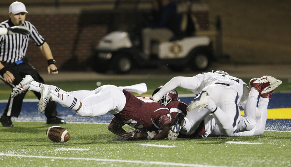 Photo - Edmond Memorial fumble inside the 5 yard line that Edmond North recovered during the high school football playoff game between Edmond North and Edmond Memorial at Watland Stadium in Edmond, Friday, November 15, 2013. Photo by Doug Hoke, The Oklahoman