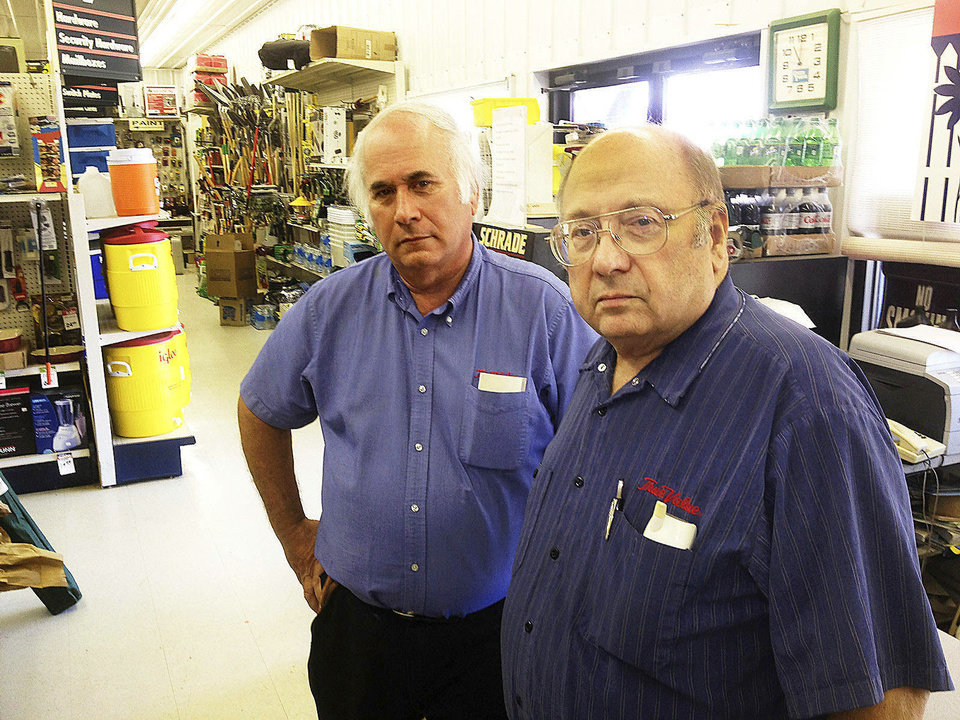 Photo - David Hope and Garland Hope Jr (l-r) at their hardware store in Purcell on Thursday, July 12, 2012. Photo by Zeke Campfield, The Oklahoman  Zeke Campfield