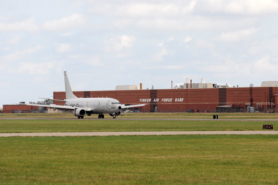 Photo -  One of eight Navy P-8 Poseidons seeking shelter from the storm touches down at Tinker Air Force Base, Oklahoma, Oct. 6. Eleven aircraft left Naval Air Station Jacksonville, Florida, for Tinker ahead of Hurricane Matthew's arrival on the East Coast. (Air Force photo by April McDonald)