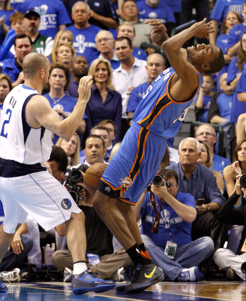 Photo - Oklahoma City's Kevin Durant (35) runs into Jason Kidd (2) of Dallas during game 5 of the Western Conference Finals in the NBA basketball playoffs between the Dallas Mavericks and the Oklahoma City Thunder at American Airlines Center in Dallas, Wednesday, May 25, 2011. Photo by Bryan Terry, The Oklahoman