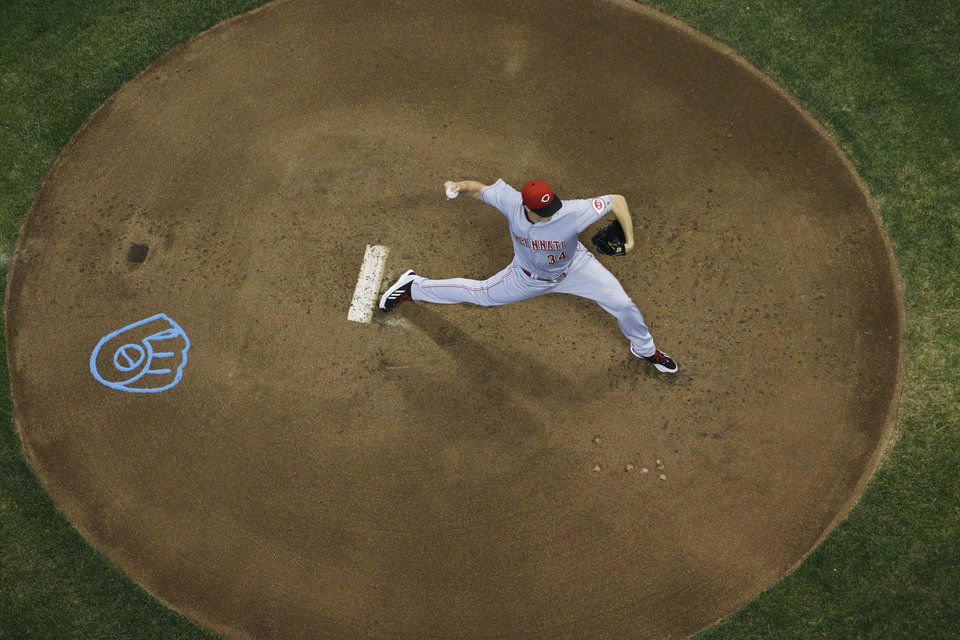 Photo - Cincinnati Reds starting pitcher Homer Bailey throws during the first inning of a baseball game against the Milwaukee Brewers Friday, June 13, 2014, in Milwaukee. (AP Photo/Morry Gash)