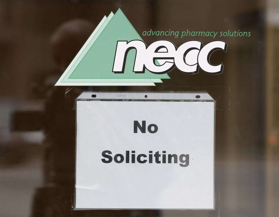 "FILE - In this Oct. 4, 2012 file photo, a sign requesting ""No Soliciting"" hangs on the door of New England Compounding in Framingham, Mass. The New England Compounding Center and its practices are under scrutiny as investigators try to determine how a steroid solution supplied by the pharmacy apparently became contaminated with a fungus. The drug has sickened more than 180 people in 12 states, killing 14. Most of the patients had received spinal injections of the steroid for back pain. (AP Photo/Stephan Savoia)"