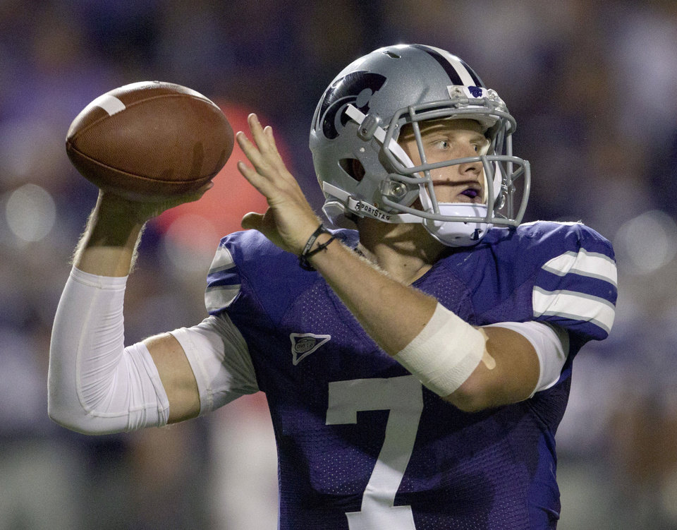 Kansas State quarterback Collin Klein (7) passes to a receiver during the second half of an NCAA college football game against North Texas in Manhattan, Kan., Saturday, Sept. 15, 2012. (AP Photo/Orlin Wagner) ORG XMIT: KSOW109