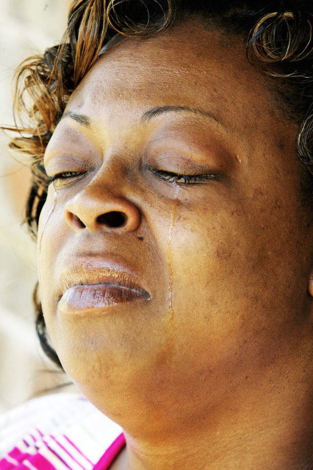 Photo - Cleta Jennings closes her eyes  while talking about her son Antwun Parker, who was killed last week during a robbery attempt.