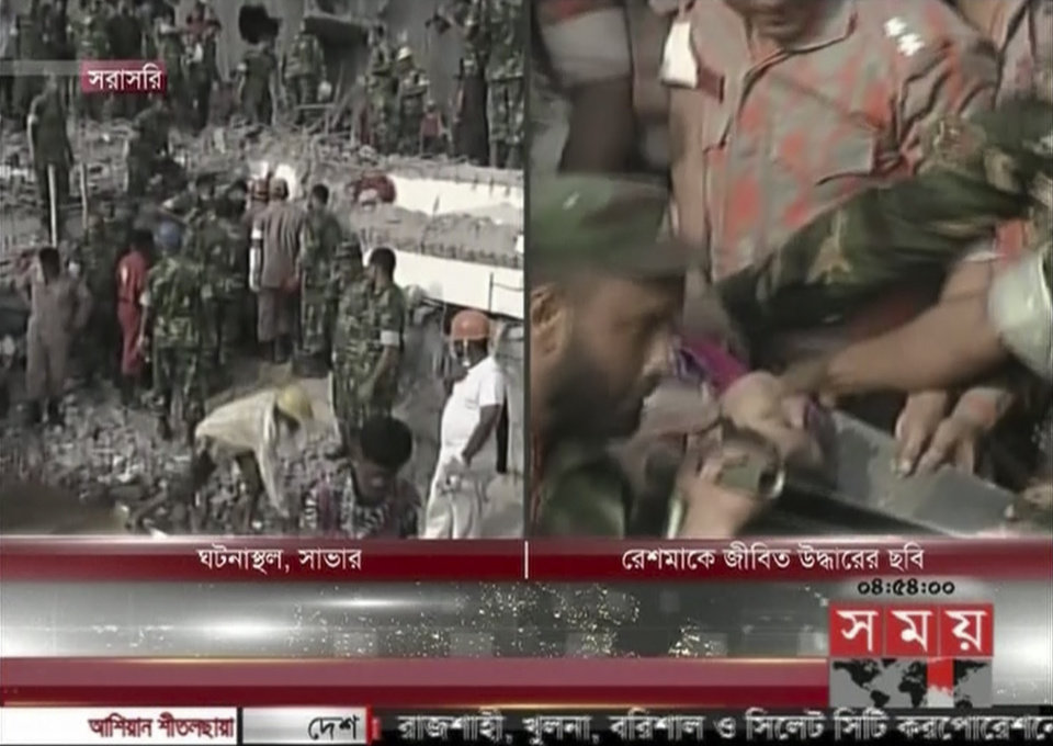 Photo - In this image taken from a TV footage released by AP video, rescuers carry a woman survivor out of a collapsed building in a right screen in Savar near Dhaka, Bangladesh, Friday, May 10, 2013. Rescue workers in Bangladesh freed a woman buried for 17 days inside a prayer room in the wreckage of a collapsed garment factory building. The amazing rescue took place Friday as the death toll from the disaster raced past 1,000, making it one of the worst industrial tragedies in history. (AP Photo/Somoy TV via AP Video) BANGLADESH OUT