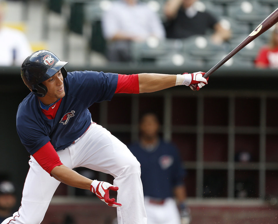 Photo - George Springer of the Oklahoma City RedHawks looks up as he drives a run in against the Iowa Cubs in the first inning of their minor league baseball game at Chickasaw Bricktown Ballpark in Oklahoma City, Friday, July 26, 2013. Photo by Bryan Terry, The Oklahoman KOD