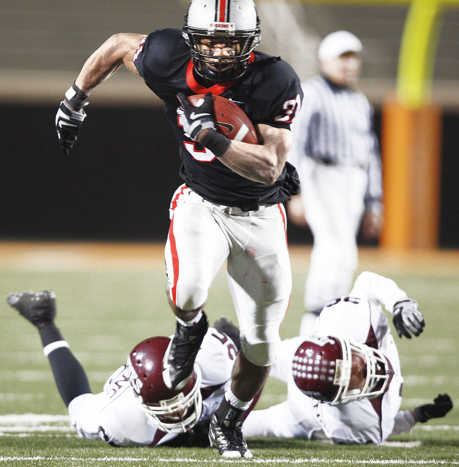 Photo - Union running back Jeremy Smith is one of the players recruited by Curtis Luper, but he says he remains firm in his commitment to the Cowboys. AP Photo