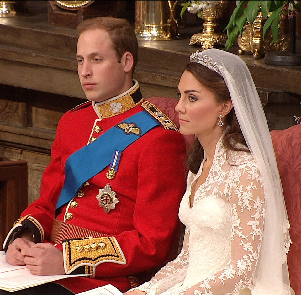 Photo - In this image taken from video, Britain's Prince William, left, sits with his wife, Kate, the Dutchess of Cambridge, at Westminster Abbey for the Royal Wedding in London on Friday, April, 29, 2011. (AP Photo/APTN) EDITORIAL USE ONLY NO ARCHIVE PHOTO TO BE USED SOLELY TO ILLUSTRATE NEWS REPORTING OR COMMENTARY ON THE FACTS OR EVENTS DEPICTED IN THIS IMAGE ORG XMIT: RWVM186