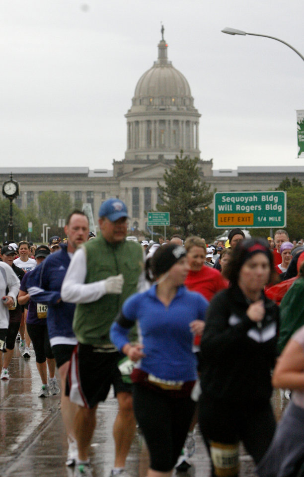 Photo - Marathoners run by the state capitol during the Oklahoma City Memorial Marathon, Sunday, May 1, 2010, in Oklahoma City. Photo by Sarah Phipps, The Oklahoman