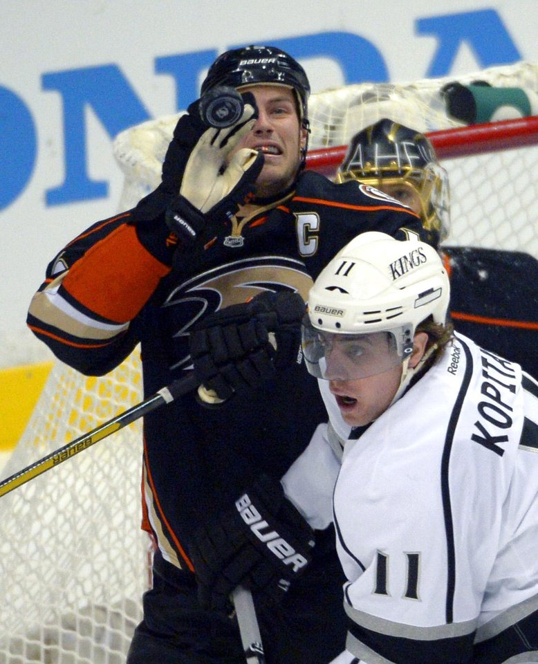Anaheim Ducks center Ryan Getzlaf, top, knocks the puck out of the air as Los Angeles Kings center Anze Kopitar, of Slovenia, reacts during the first period of their NHL hockey game, Saturday, Feb. 2, 2013, in Anaheim, Calif. (AP Photo/Mark J. Terrill)