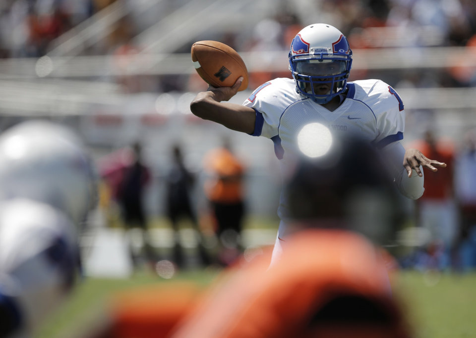 Photo - Millwood's London Potts (1) throws a pass during a high school football game between Douglass and Millwood in Oklahoma City, Saturday, Sept. 8, 2012.  Photo by Garett Fisbeck, The Oklahoman