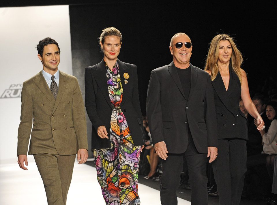 Photo - Project Runway judges, from left, Zac Posen, Heidi Klum, Michael Kors and Nina Garcia greet guests before the showing of the finalists Fall 2013 collection during Fashion Week, Friday, Feb. 8, 2013 in New York. (AP Photo/Louis Lanzano)