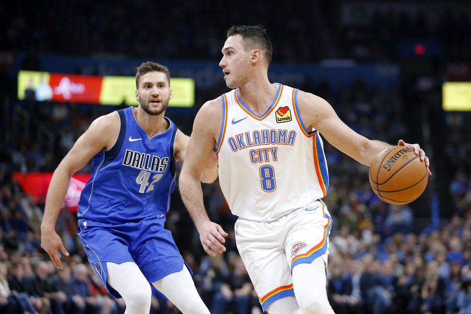 Photo - Oklahoma City's Danilo Gallinari (8) goes past Maxi Kleber (42) of Dallas during an NBA basketball game between the Oklahoma City Thunder and the Dallas Mavericks at Chesapeake Energy Arena in Oklahoma City, Tuesday, Dec. 31, 2019. [Bryan Terry/The Oklahoman]