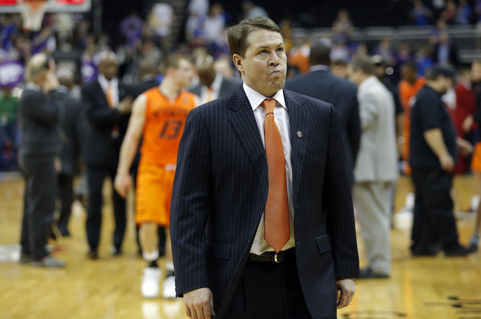 Oklahoma State head coach Travis Ford walks off the court following the Cowboys' loss at the Phillips 66 Big 12 Men's basketball championship tournament game between Oklahoma State University and Kansas State at the Sprint Center in Kansas City, Friday, March 15, 2013. Photo by Sarah Phipps, The Oklahoman