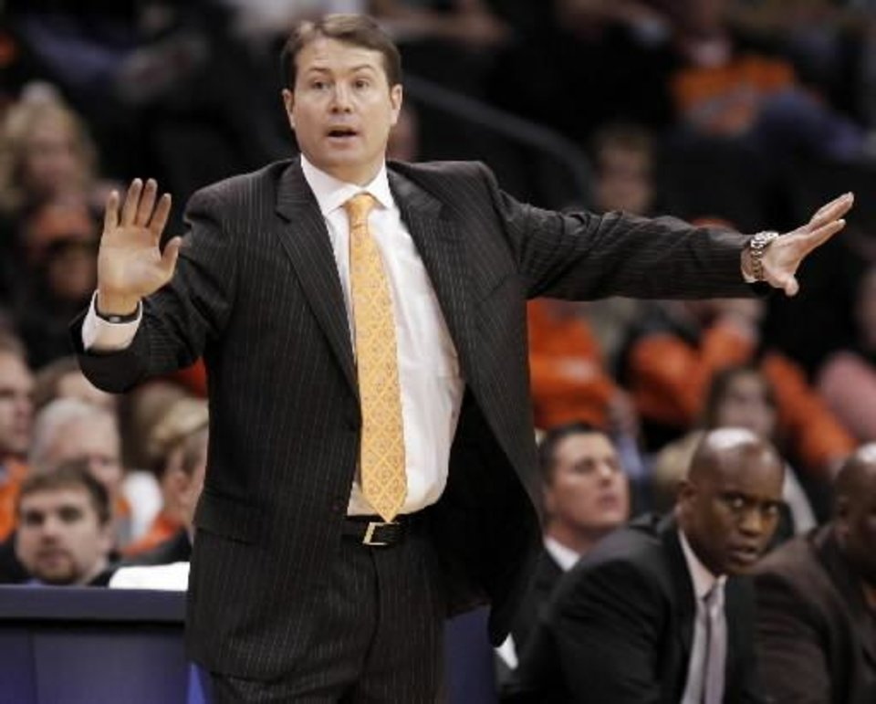Photo - OSU head coach  Travis  Ford gives instructions to his team during the first half of the college basketball game between Oklahoma State University (OSU) and La Salle University in the All College Basketball Classic at the  Ford Center on Monday, Dec. 21, 2009, in Oklahoma City, Okla. Photo by Nate Billings
