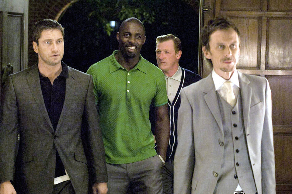 "Gerard Butler as One Two, Idris Elba as Mumbles, Geoff Bell as Fred the Head and Matt King as Cookie in a scene from ""RocknRolla."" Warner Bros. Pictures <strong></strong>"