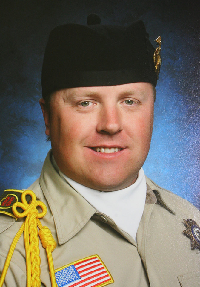 Photo - This photo provided by the San Bernardino sheriff's department shows slain San Bernardino Sheriff Deputy Jeremiah MacKay. MacKay was killed Tuesday, Feb. 12, 2013 during a shootout outside the cabin where fugitive ex-Los Angeles police officer Christopher Dorner was believed to be barricaded inside in Big Bear, Calif. After the firefight ended, a SWAT team using an armored vehicle broke out the cabin's windows and began knocking down walls. A fire broke out and later charred remains believed to be Dorner's were found. (AP Photo/San Bernardino Sheriff's Department via The Riverside Press-Enterprise)