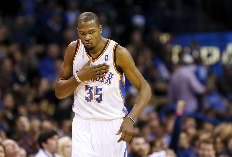 Oklahoma City\'s Kevin Durant (35) pats his chest after making a 3-point shot during an NBA basketball game between the New York Knicks and the Oklahoma City Thunder at Chesapeake Energy Arena in Oklahoma City, Sunday, Feb. 9, 2014. Oklahoma City won, 112-100. Photo by Nate Billings, The Oklahoman